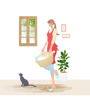 洗濯カゴを持つ女性と猫