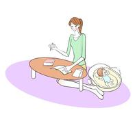 寝ている赤ちゃんの横で勉強するママ