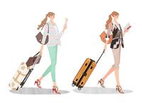スーツケースを引いて本を読みながら歩く女の子