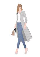 ロングカーディガンを着て街を歩く女性