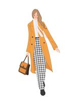 チェスターコートを着てカバンを持って出かける女性