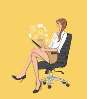 椅子に座りタブレットを楽しむ女性