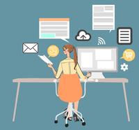 オフィスでデスクに座りパソコンを使って仕事をする女性