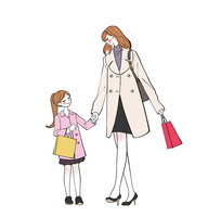 手をつないで買い物をして歩くママと子供