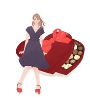 チョコレートの入ったプレゼントの箱に座る女の子