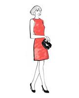 ワンピースのドレスを着て立つ女性