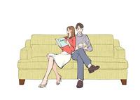 ソファに座り本を読む男性と女性