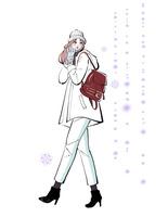 雪を見ながら歩く帽子と手袋をつけた女性