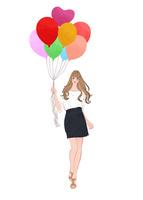 風船を持って立つ春の女性