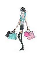 ショッピングバックを持つ若い女性