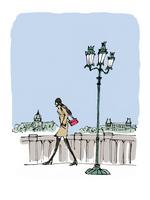 街灯のある橋の上を歩くコート姿の女性(背景なし)