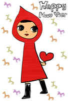 ハートを持って立っている赤ずきんを着た女の子