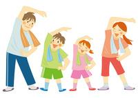 運動をする笑顔の家族