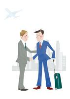 スーツケースを持ち握手をするビジネスマン
