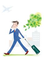 スーツケースと携帯を持つビジネスマン