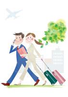 スーツケースを持つビジネスマンとオフィスレディ