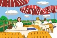 旅行先のカフェでくつろぐ女性