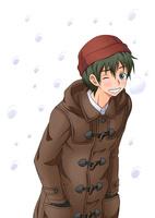 寒さに肩をすくめる男子学生