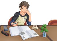 カフェで勉強する男子