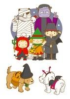 フランケンとミイラ男とハロウィンの仮装の子供と犬