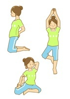 腰や上半身のストレッチをする女性