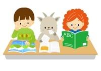 本を広げて勉強をする子供たちとヤギ