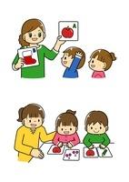 カードで勉強する幼児と先生
