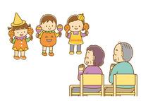 ハロウィンの衣装を着て演奏する子どもと、拍手する老人たち