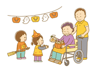 車椅子に座ったおばあさんにハロウィンのお菓子をもらう子どもたち