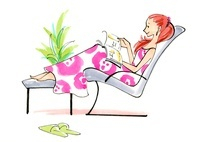 アームチェアに座りながら本を読んでいる女性