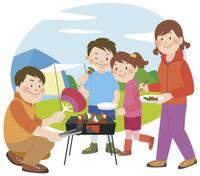 キャンプでバーベキューをしている家族