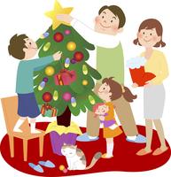 赤いカーペットの上でクリスマスツリーの準備をする4人家族