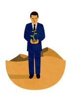 植物を手に砂漠の上に立つサラリーマン 10471000175| 写真素材・ストックフォト・画像・イラスト素材|アマナイメージズ