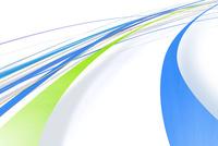 大きく円を描くように流れる青と緑のライン(光)