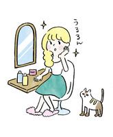 鏡の前で化粧をする女の子