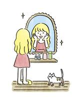 鏡の前に立って化粧をする女の子