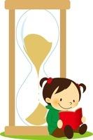 砂時計によりかかって本を読む女の子