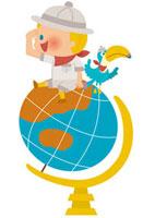 地球儀に乗る探検家の男の子