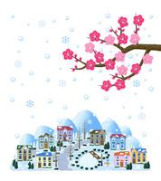 梅と雪の降る街並
