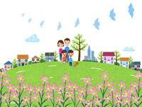 花咲く丘を散歩する家族
