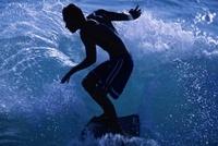 サーフィンをする男性シルエット  ハワイ