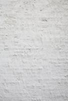 タイル地に白い漆喰を塗った壁のテクスチャ