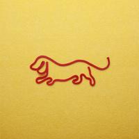 赤い紐でつくった犬(戌)のイメージ 10610003811| 写真素材・ストックフォト・画像・イラスト素材|アマナイメージズ