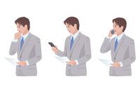 スマートフォンで仕事をする男性