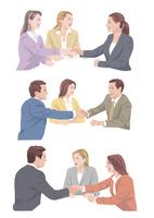 外国人スタッフと握手をするビジネスマン