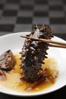 なまこ料理(黒バック) 10724006664| 写真素材・ストックフォト・画像・イラスト素材|アマナイメージズ