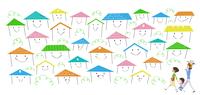 たくさんの住宅が立ち並ぶ町を訪れる家族