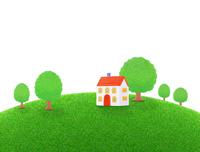 芝生の丘の家と樹木
