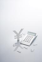 電卓と通貨マーク