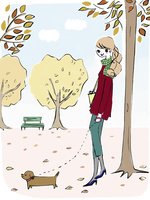 秋の公園を犬と散歩する女性